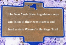 Travel sign promoting women's heritage trails